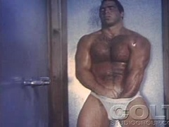 Solo body builder whacking off soft dick